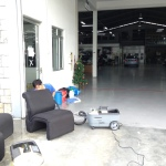 Cleaning Seats at BMW Service Centre.