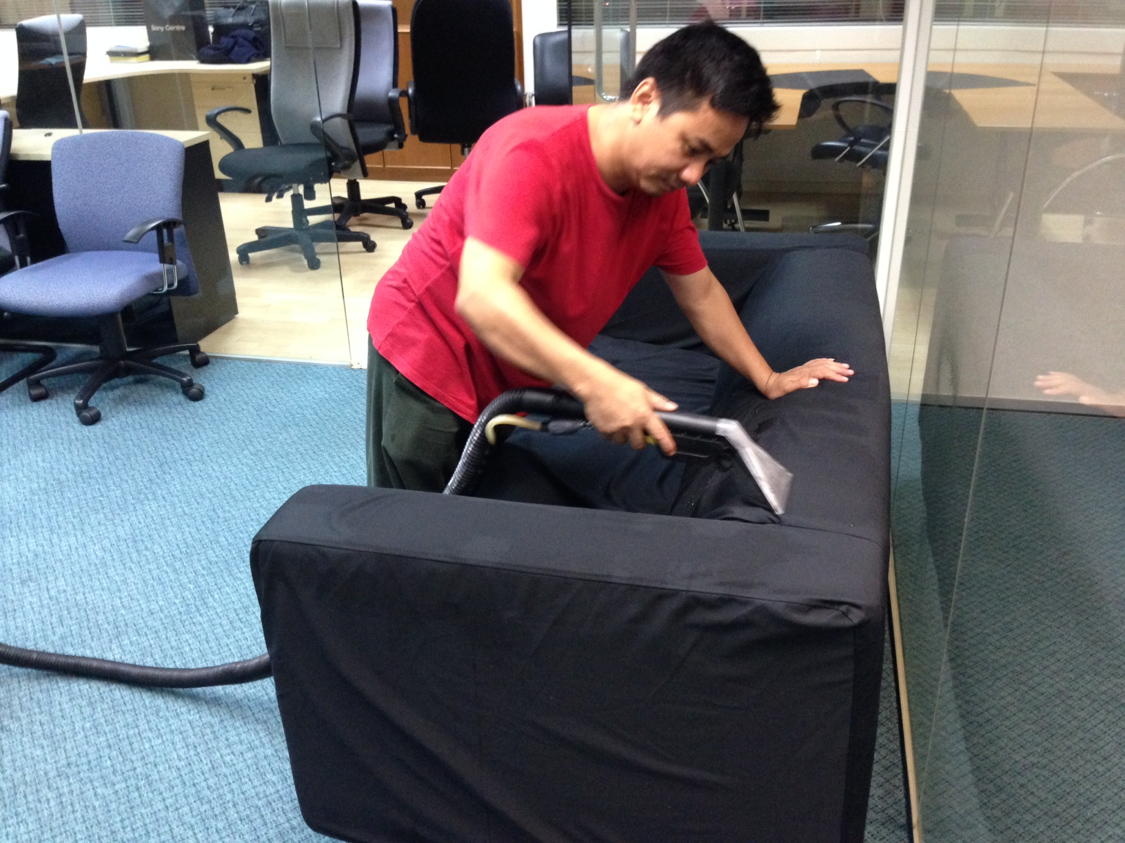 Cleaning sofa in office.