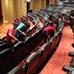 Cleaning fabric chairs in this auditorium
